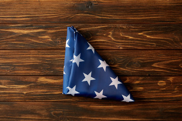 elevated view of folded united states flag on wooden surface