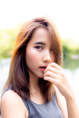 Portrait charming beautiful asian woman. Attractive Thai girl has beautiful face. Gorgeous woman looks confident. Glamour lady has honey skin and long hair. She looks so charming and relaxing