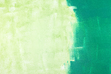 unfinished painted wall with green color by paint roller