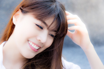 Portrait charming beautiful woman: Attractive girl feel happiness. Gorgeous woman has nice skin and beautiful white teeth. Glamour lady think something that makes her smile and shy. Asian girl is cute