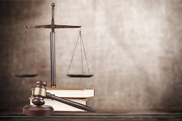 Justice Scales with books and wooden gavel
