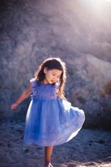 Portrait of girl in purple dress in sunlight