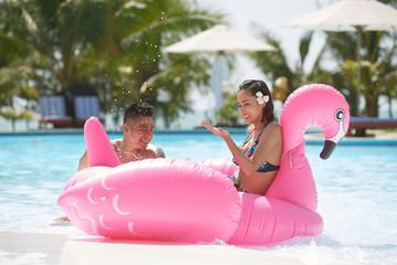 Joyful couple in pool
