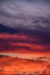 romantic sunset with clouds as background
