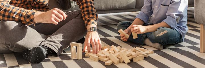 Man and kid arranging bricks
