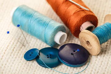 colored thread and buttons