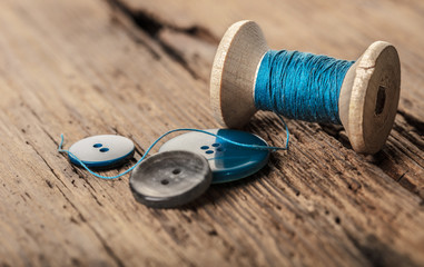 spool of threads and buttons