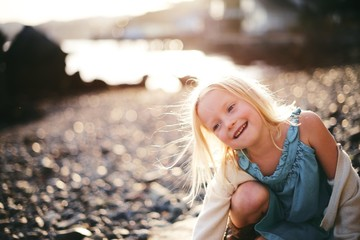 Girl with golden light at the beach
