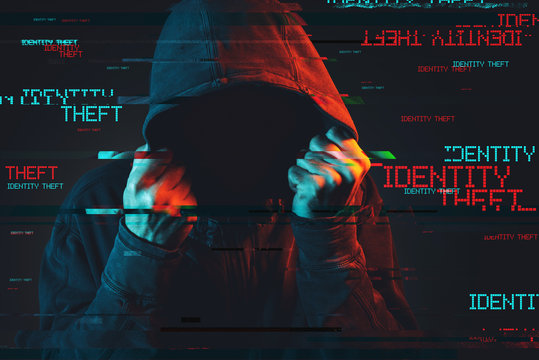 Online identity theft concept with faceless hooded male person