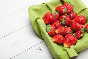 Natural strawberry on wooden table, copy space for text.