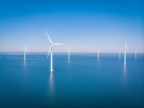drone view at an windmill farm at sea
