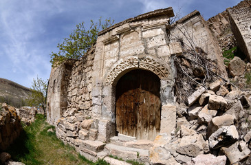 Gate to medieval greek house with floral ornament,abandoned turkish village,Cappadocia