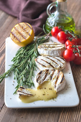 Grilled Camembert cheese with olive oil and rosemary