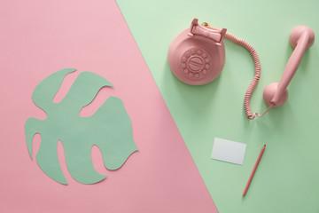 Vintage phone and paper leaf