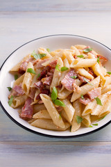 Penne pasta with bacon and sundried tomatoes