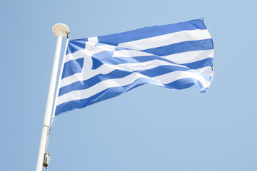 greek flag on a mat in the wind and blue sky