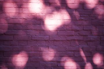 Light bulbs on purple bricks background