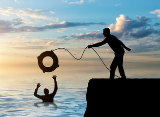 A silhouette of a man throws a lifeline to another man who is drowning in the water Fototapete