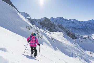Woman on skiing slope, Bavaria, Germany, Europe