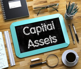 Capital Assets Concept on Small Chalkboard. 3d