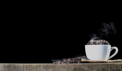 coffee beans in cup wish smoke black back ground