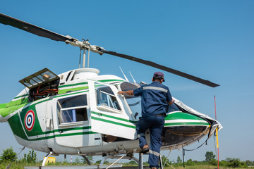 Helicopter parked at the helipad in airport