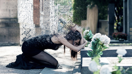 Afflicted woman portrait in grief in front of a grave - Dispersion effect