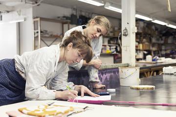 Textile designers working in workshop