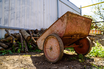 Old rusty wheelbarrow in garden