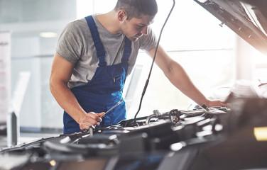 Fotobehang Zeilen Auto mechanic working in garage. Repair service
