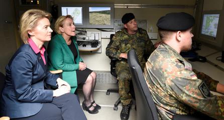 German Defence Minister Ursula von der Leyen and her Dutch counterpart Ank Bijleveld inspect a tactical indoor simulator as they visit Bundeswehr tank battalion 414 in Lohheide