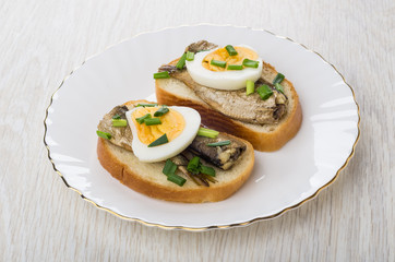 Sandwiches with canned sprats, chopped scallion and boiled eggs