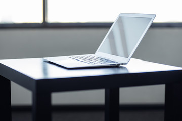 Stylish and classy, the laptop in the workplace.