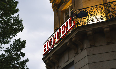 Illuminated hotel sign taken in Paris at sunset