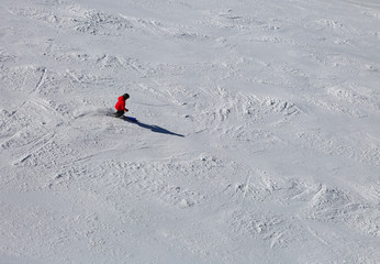 skier in the slope with snow