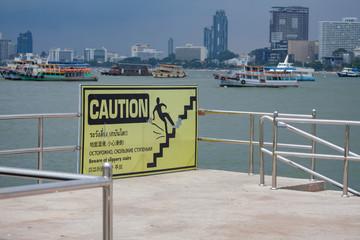 Warning signs fall asleep in various languages.