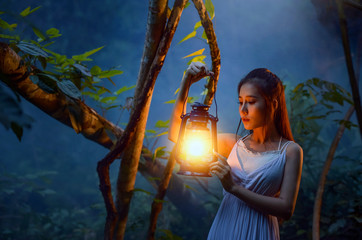Mysterious Forest Nymph,Medieval Woman with Vintage Lantern Outside at Night ,girl holding a lamp