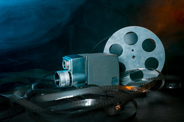 8 mm movie camera with a reel of film in smoke