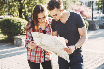 Traveling, sightseeing, city tour, vacation, holiday. Couple searching the location on map, choosing place to go