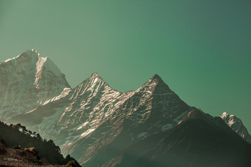 Ideal background in the emerald shade for the different kinds of collages, illustrations and digital media. The Thamserku Mountain, Himalayas. Eastern Nepal.