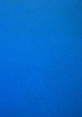 Textura de parede pintada de tinta azul sem brilho.