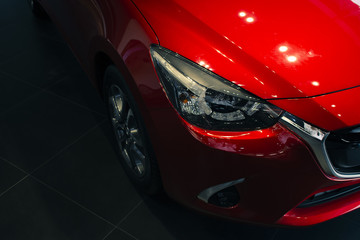 This Front car all new red color on room customer backbround parked in showroom of thailand for...