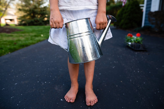Girl holding watering can