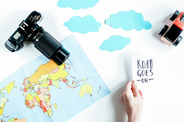 children tourism outfit with map and camera on white background
