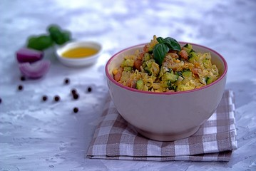 Vegetable salad of fresh cabbage with cucumber, boiled eggs and white beans
