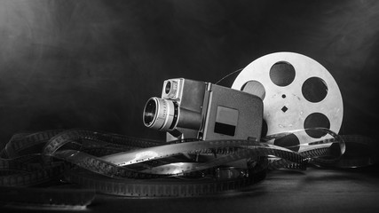 8 mm movie camera with a reel of film in smoke. black and white