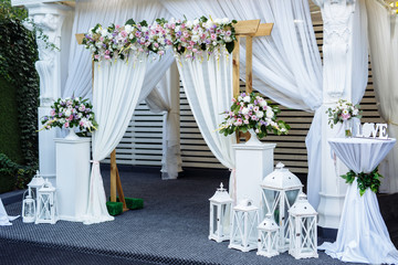 Wedding ceremony.Arch decorated with beautiful flowers. Wedding