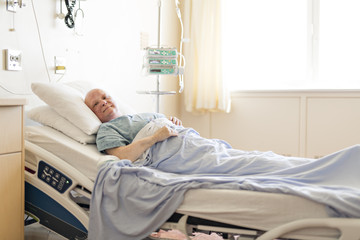 woman in hospital bed suffering from cancer