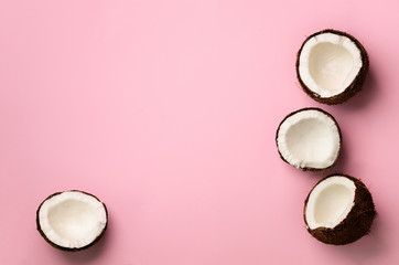 Pattern with ripe coconuts on pink background. Top View. Copy Space. Pop art design, creative...