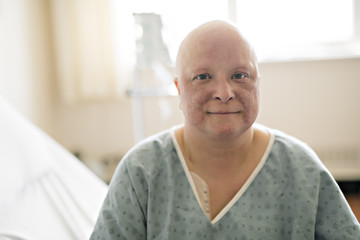 woman in hospital bed suffering from cancer Wall mural